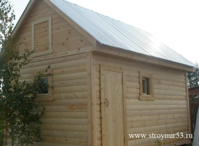 Дом из профилированного бруса с гаражом фото